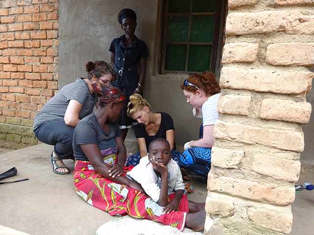 Jennifer, Lisa and Charlotte working together to help Faith, a 10-year-old with pressure sores - he is probably the most patient little boy around.