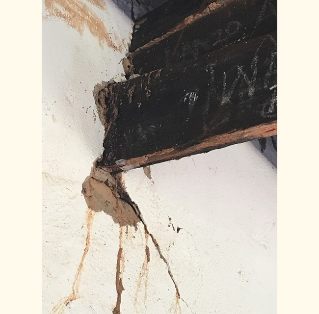 Termites have eaten the beams, and the walls are cracking