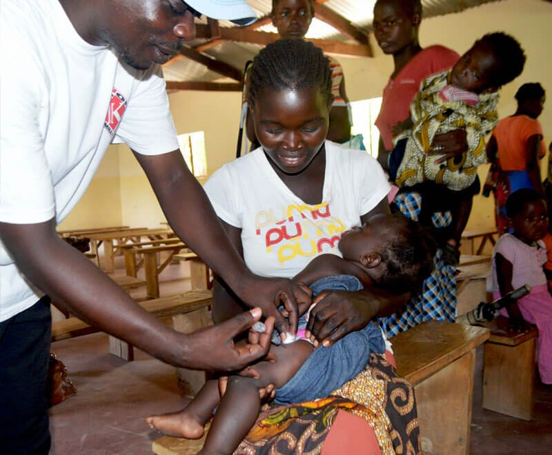 Child receiving a vaccination in Malawi