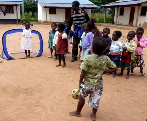 Children playing football during breaktime in rural Africa