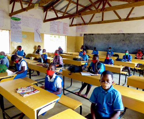 Primary standard 8 pupils return to class in Malawi