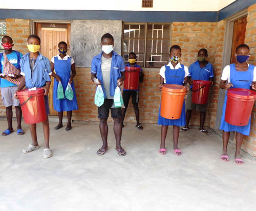Buckets and soap have been distributed to primary schools in Malawi