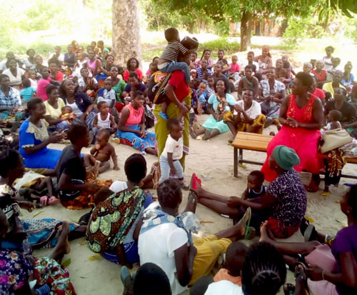 A woman demonstrates the struggles of having too many children in Malawi