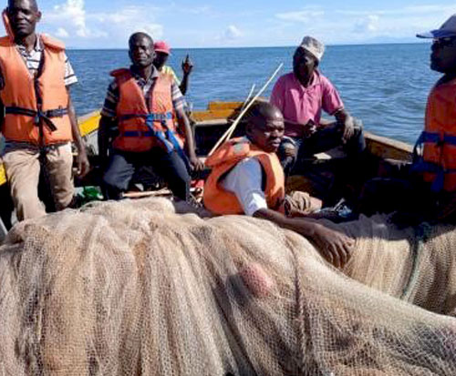 A fisheries department in Malawi carry out confiscation of illegal fishing nets