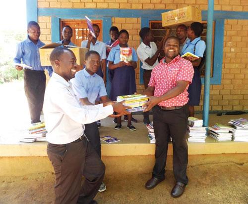 Students and teachers at Kapanda school in Malawi receive new textbooks