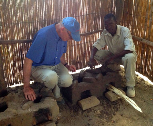 Duncan learning to build a fuel efficient cookstove in Malawi