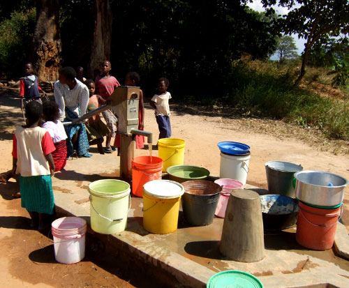 A busy borehole in Malawi
