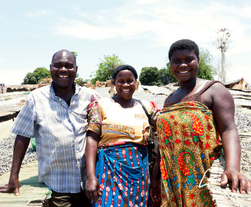 A fishing family smile happily in Malawi