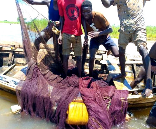 A local fishing crew show their bunt eight fishing net in Malawi