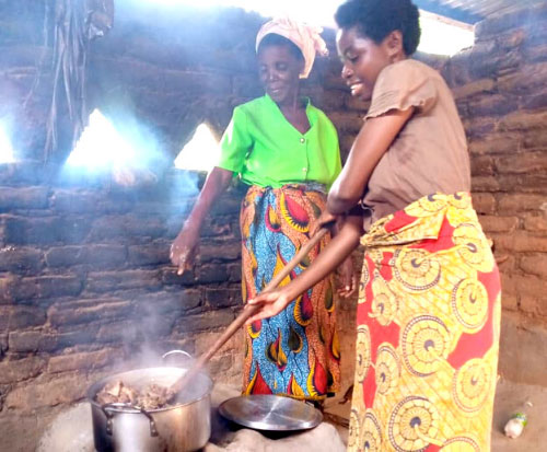 Catherine cooking on her cookstove in Malawi