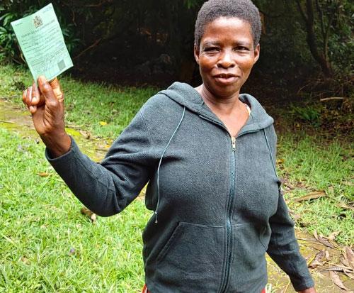 Martha shows her coronavirus vaccination passport in Malawi