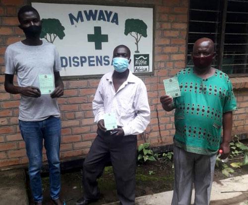 Teachers from Matete Primary School show their coronavirus vaccination passport in Malawi