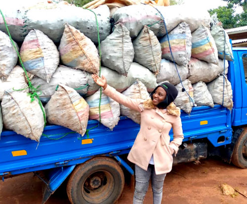 One of our team stand with the lorry full of confiscated illegal charcoal in Malawi