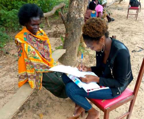 Khumbo talking with one of the women about family planning in Malawi