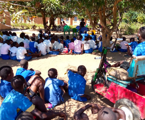 Matilda carries out a disability awareness talk at a primary school in Malawi